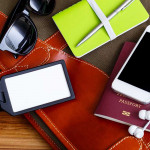 Travel bag and blank tag with passport phone and sunglasses notebook for tourism concept
